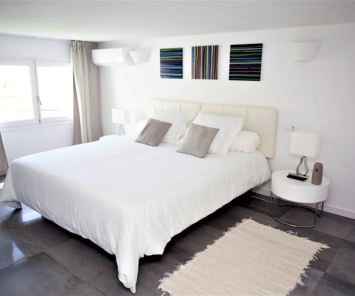 bedroom with windows villa in ibiza