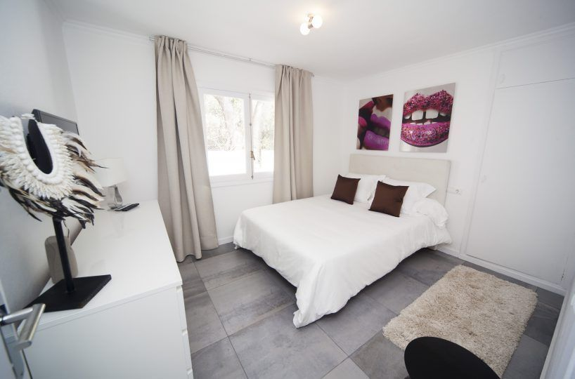 large bedroom of villa in ibiza