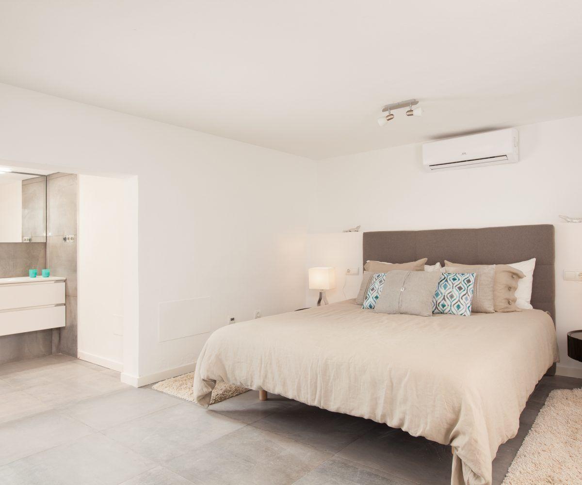 bedroom with bathroom en suite villa in ibiza